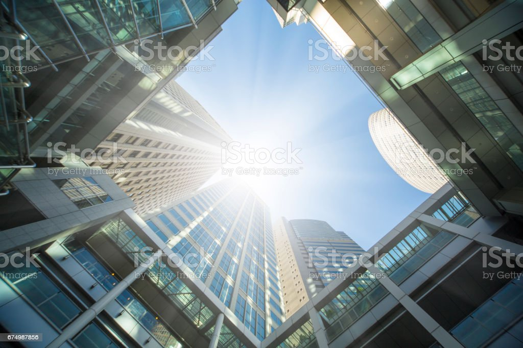 Look up the urban high-rise office building from below stock photo