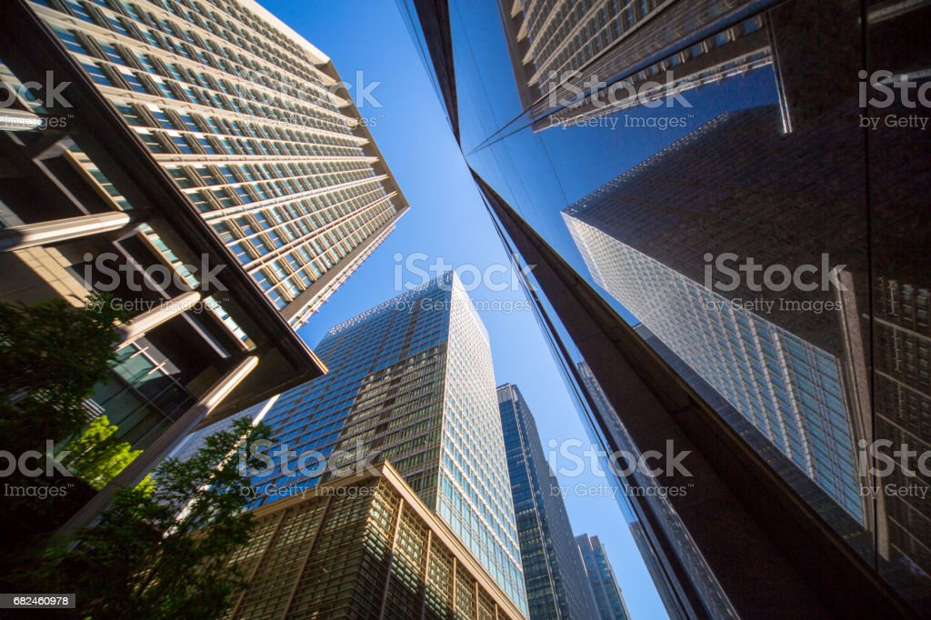 Look up the urban high-rise office building from below royalty-free stock photo