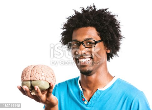 613542420 istock photo Look what I got! Mad scientist smiling with model brain 185214446