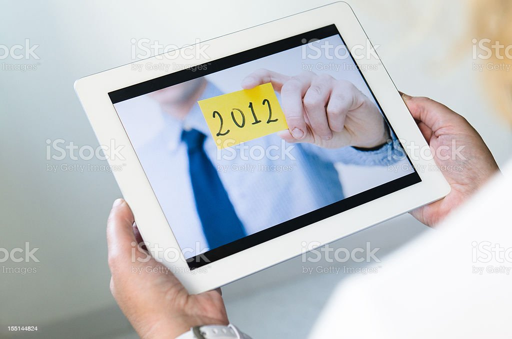 looking a 2012 business card photo on digital tablet royalty-free stock photo