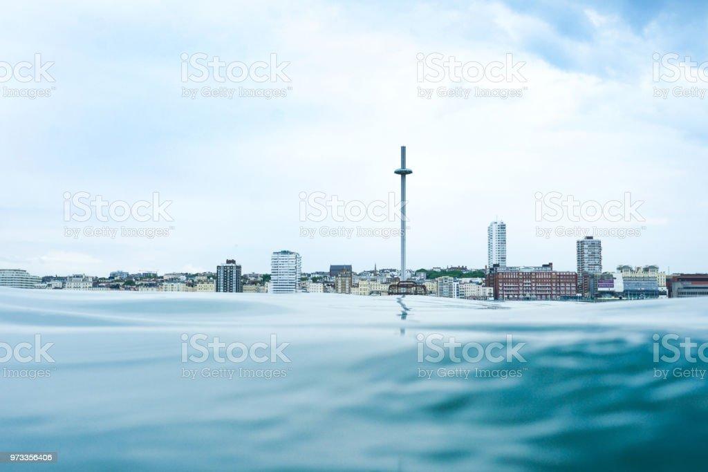 looking across acalm sea to Brighton UK skyline stock photo