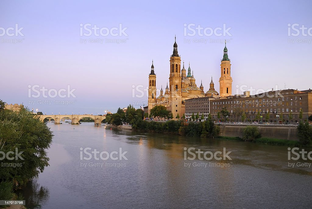Looking across the river at a distant mosque stock photo