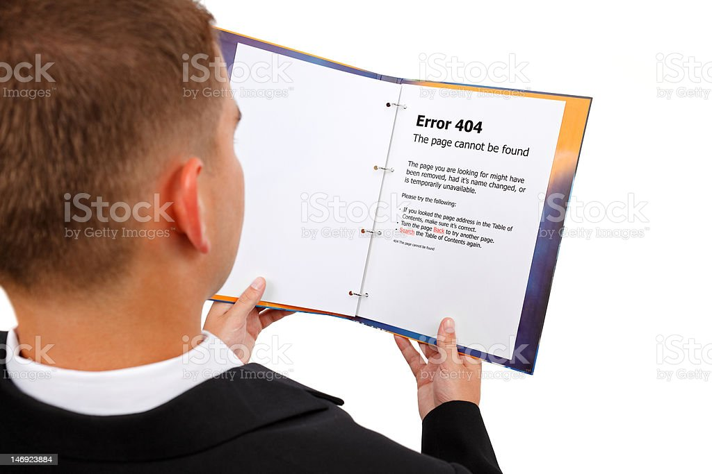 Looking at 404 error page in book stock photo