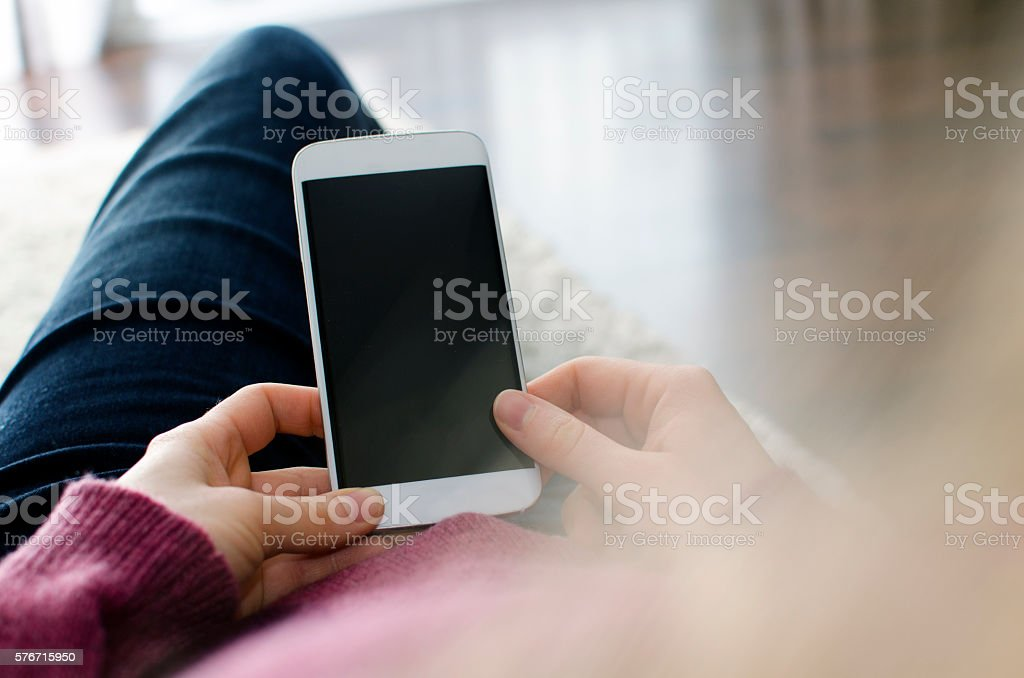 Looking at a blank smart phone screen with copy space stock photo