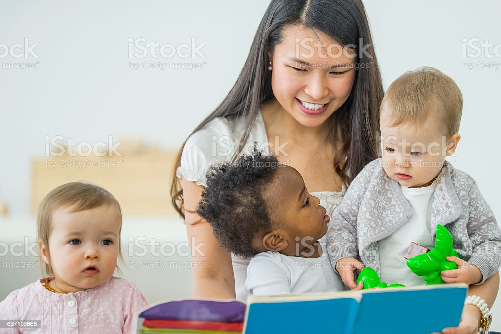 Looking at a Book Together stock photo