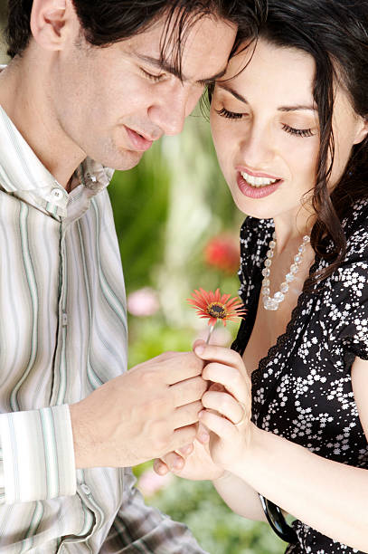 Looking at a Flower stock photo