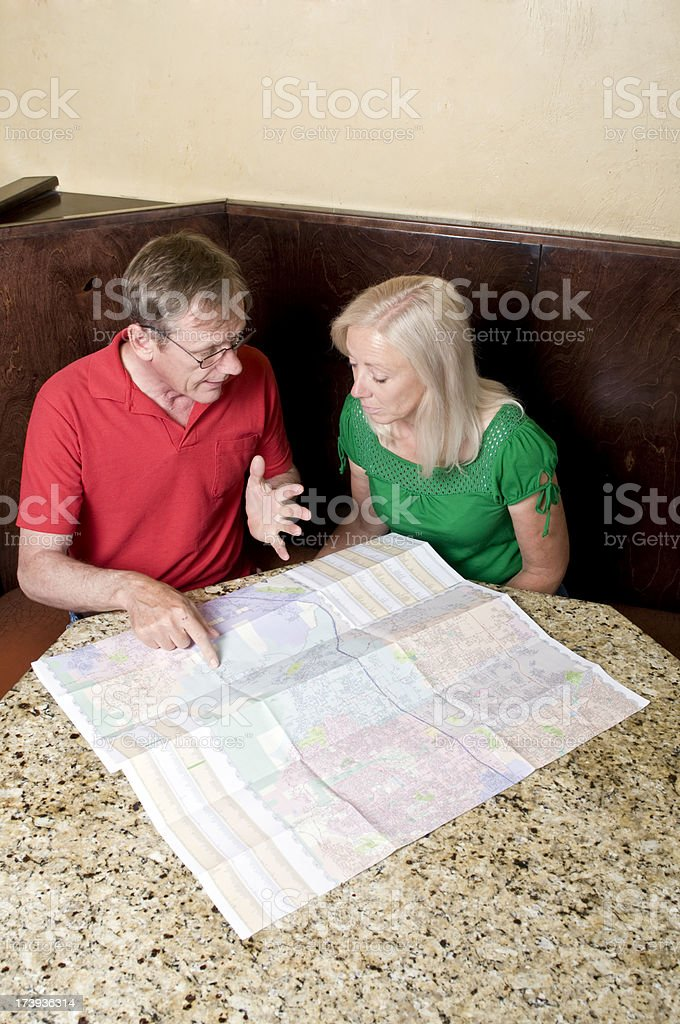 Looking at a map stock photo