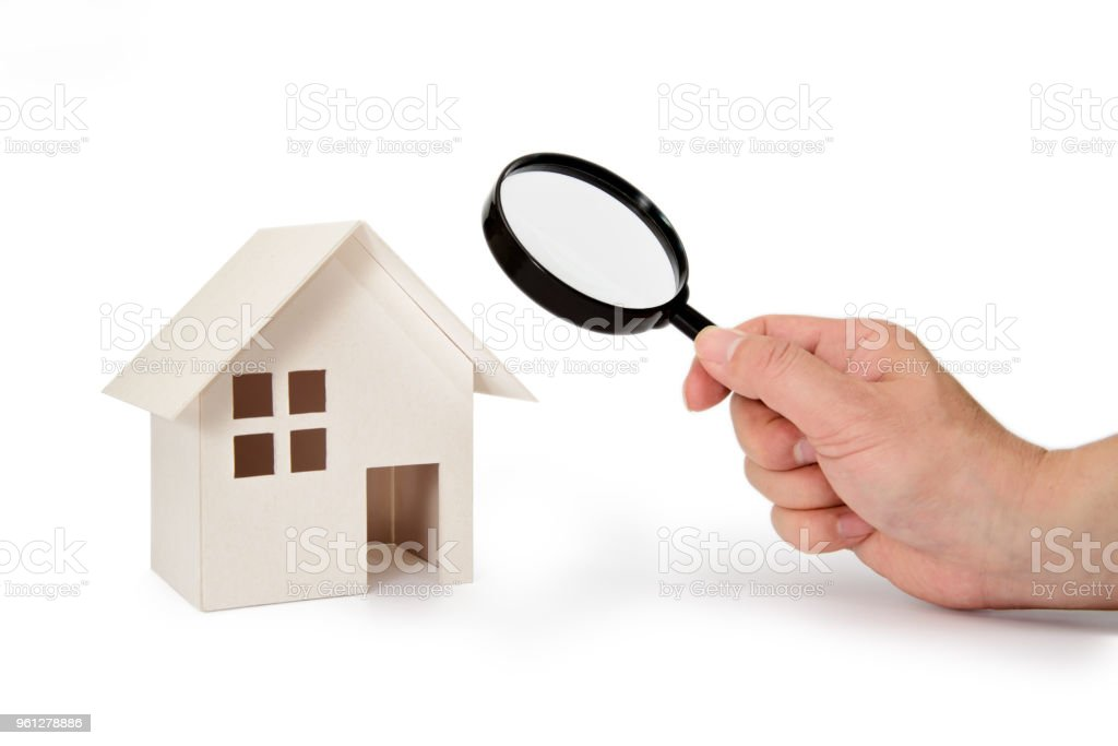 Looking at a model house. stock photo