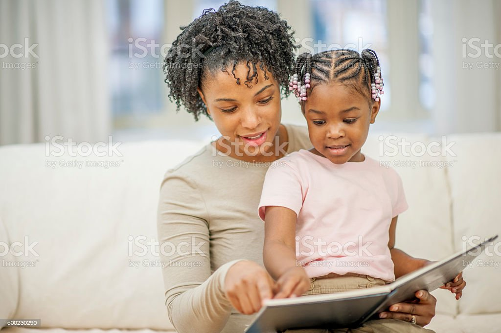 Looking at a Picture Book Together stock photo