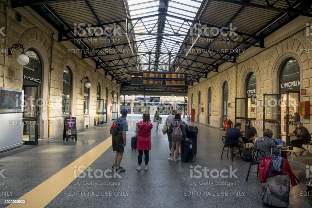 Looking at an information display at Bologna train station stock photo
