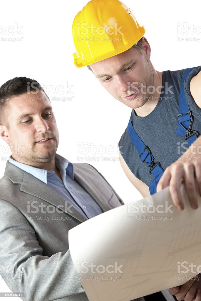Looking at blueprints royalty-free stock photo