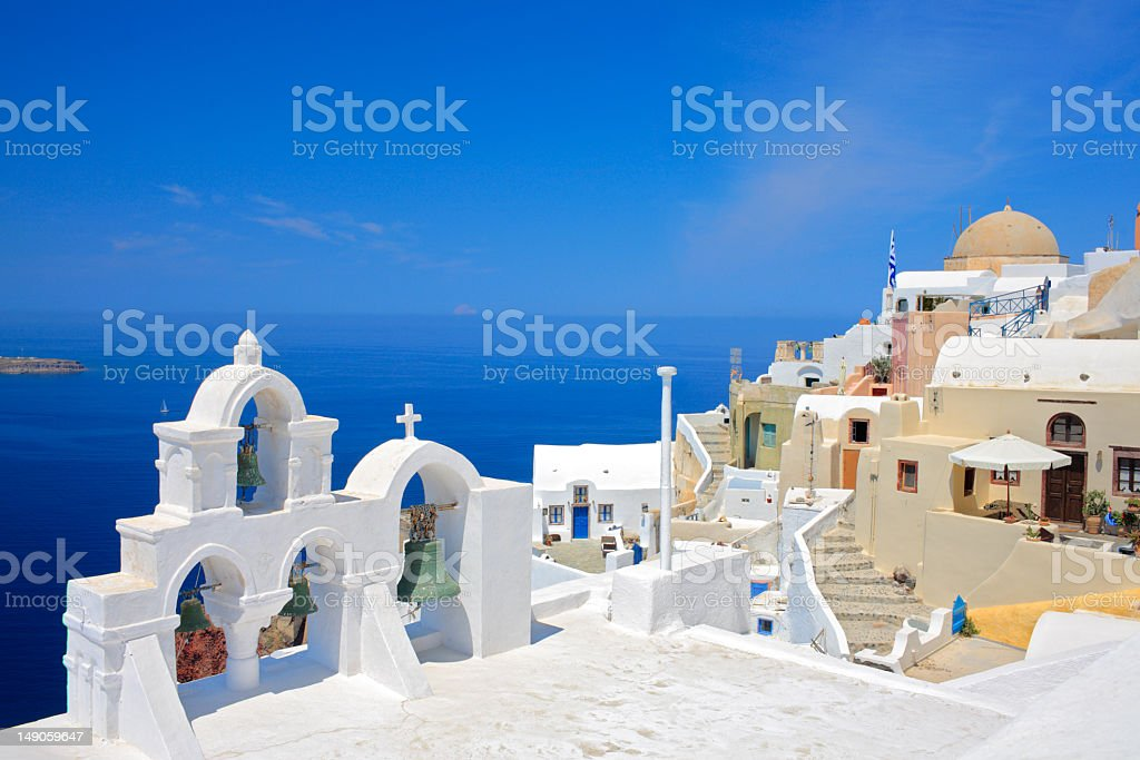 Looking at church bells and the ocean of Santorini Island royalty-free stock photo
