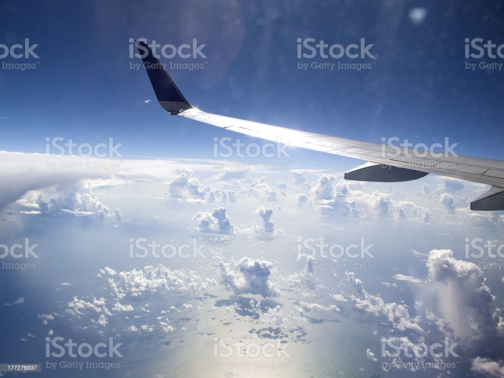 Looking at clouds through an airplane window royalty-free stock photo