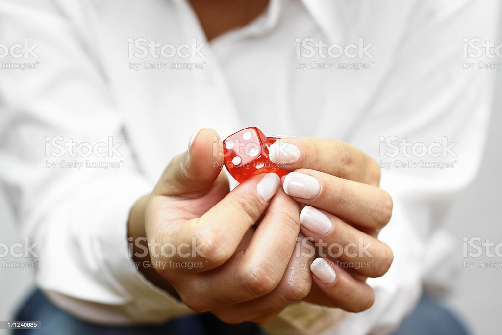 Looking at dices stock photo