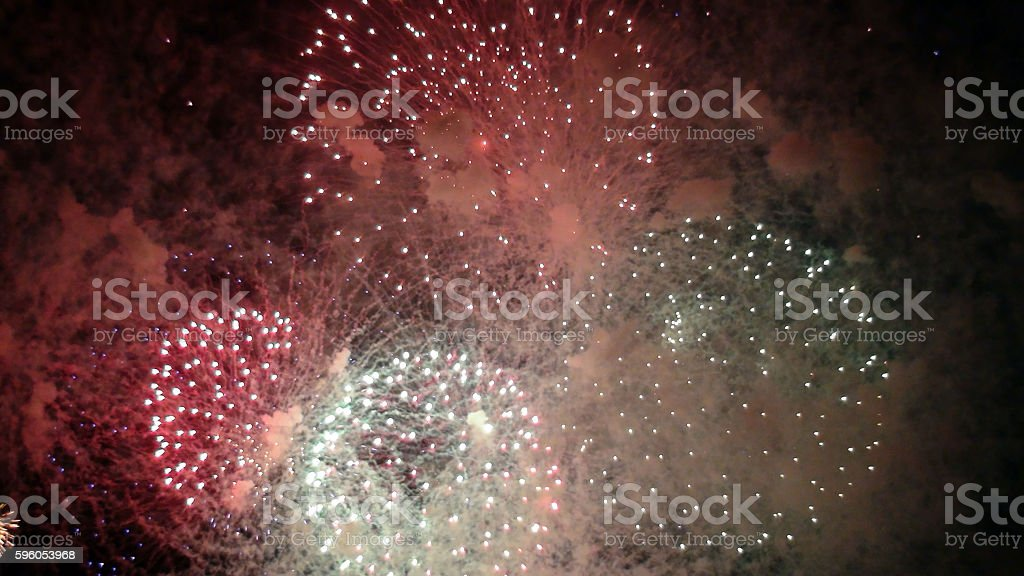 Looking At Fireworks Lights Exploding In The Night royalty-free stock photo