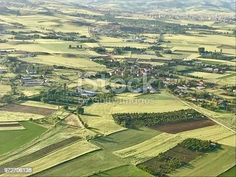 Looking at from the airplane window to the green nature and the villagers.