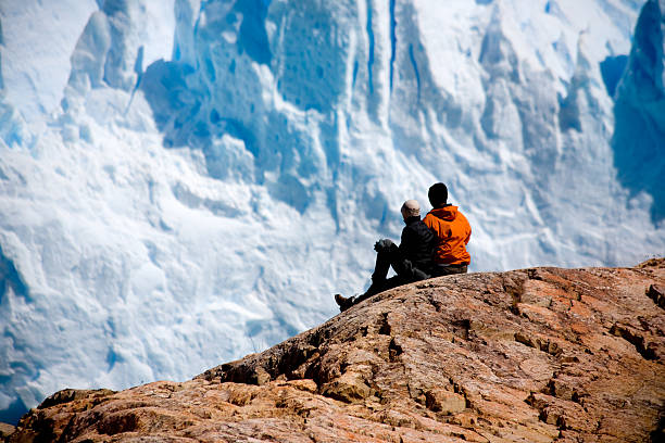 Looking at glacier stock photo