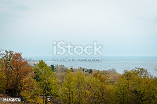 177362898istockphoto Looking at Grand Havens lighthouse off in the distance from Muskegon Michigan 981808276