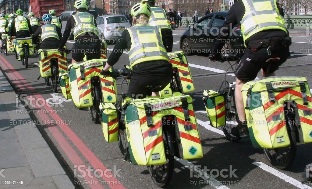 Looking At London Ambulance Paramedics Crews On The Road With Bicycle In London.England stock photo