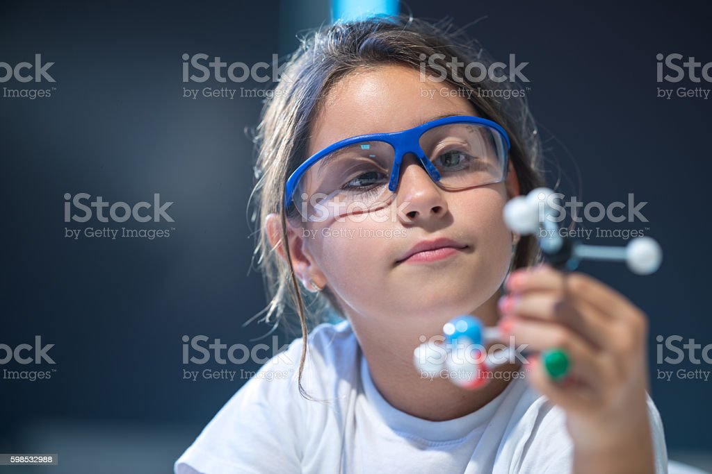 Looking at molecular structure model. stock photo