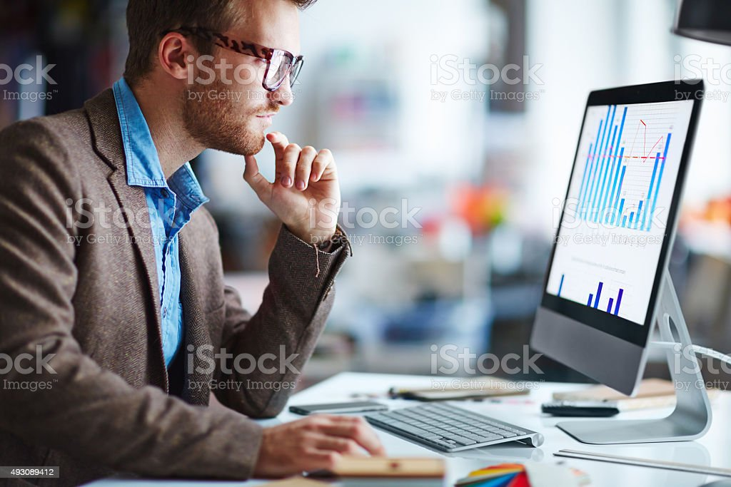 Looking at monitor stock photo