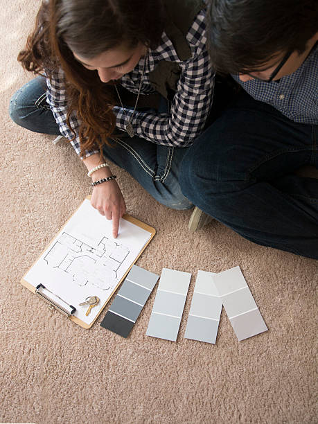 looking at paint swatch stock photo