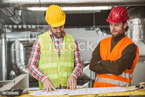 istock Looking at plans 667339490