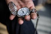 Man holding stylish pocket watch in his hand