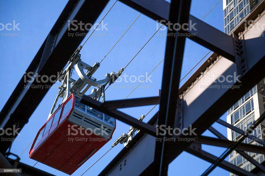 Looking at Roosvelt island tram car through metal bridge frame stock photo