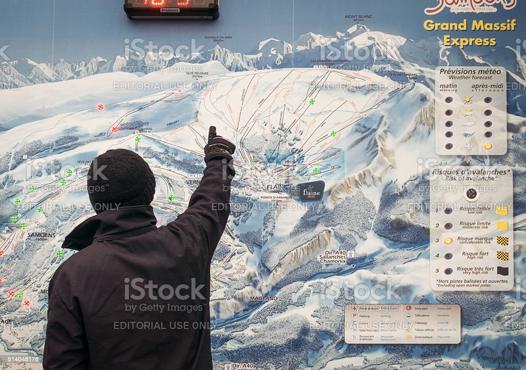 Looking at ski piste map stock photo