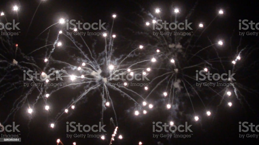 Looking At Sparkling Fireworks At Night royalty-free stock photo
