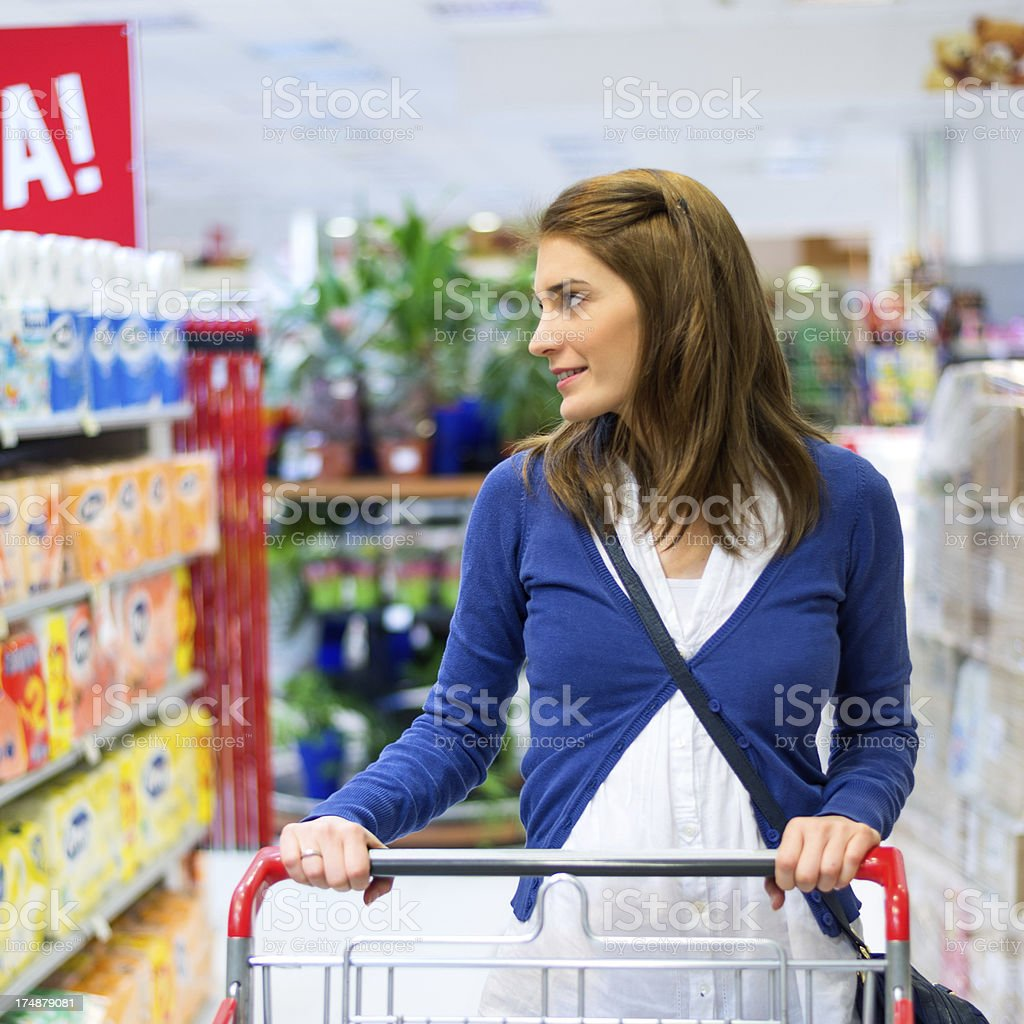 Looking at supermarket shelf royalty-free stock photo