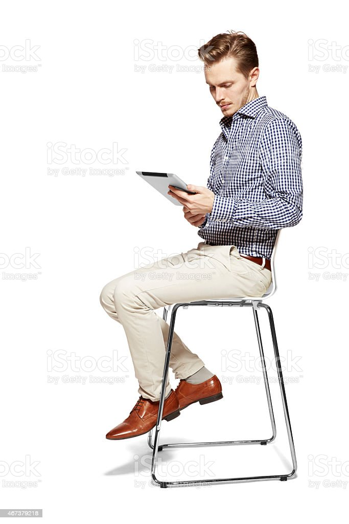 Looking at tablet stock photo