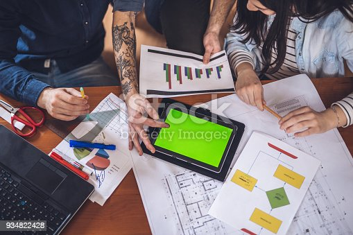 557608497istockphoto Looking at the charts 934822428
