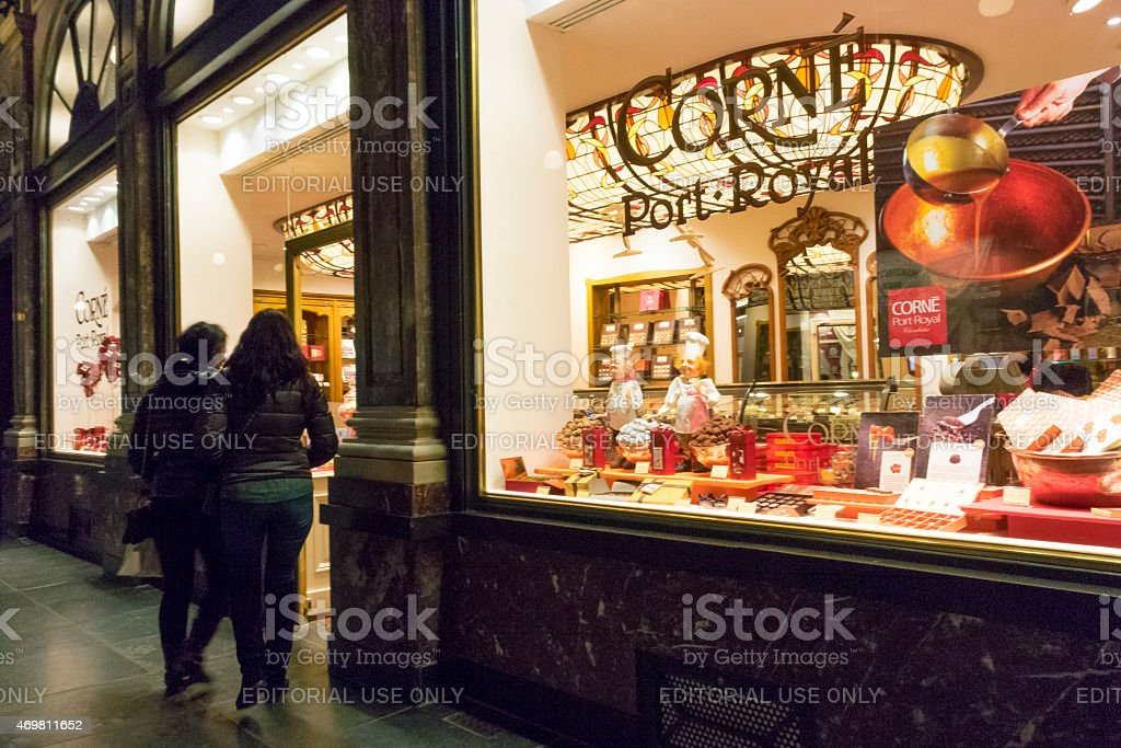 Looking at the chocolate shop in Brussels stock photo