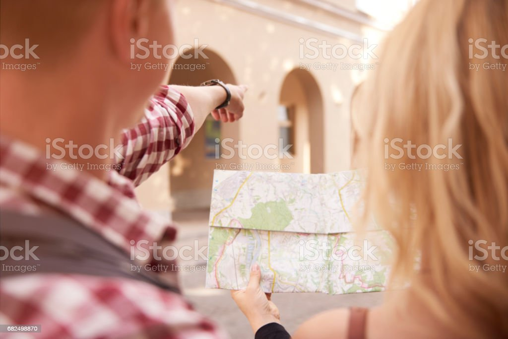 Looking at the directions from the map royalty-free stock photo