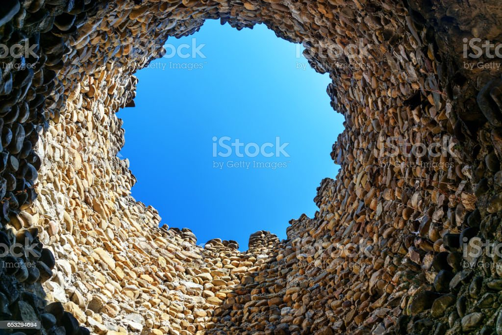 Looking at the sky through hole in tower. Sighnaghi city wall. It is...