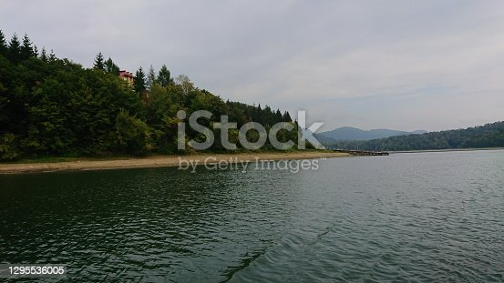 istock Looking at the surface of a large and beautiful mountain lake 1295536005