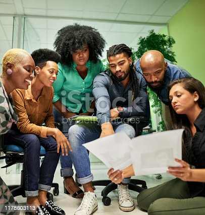 Shot of a multi-ethnic business group planning together on a project at creative office