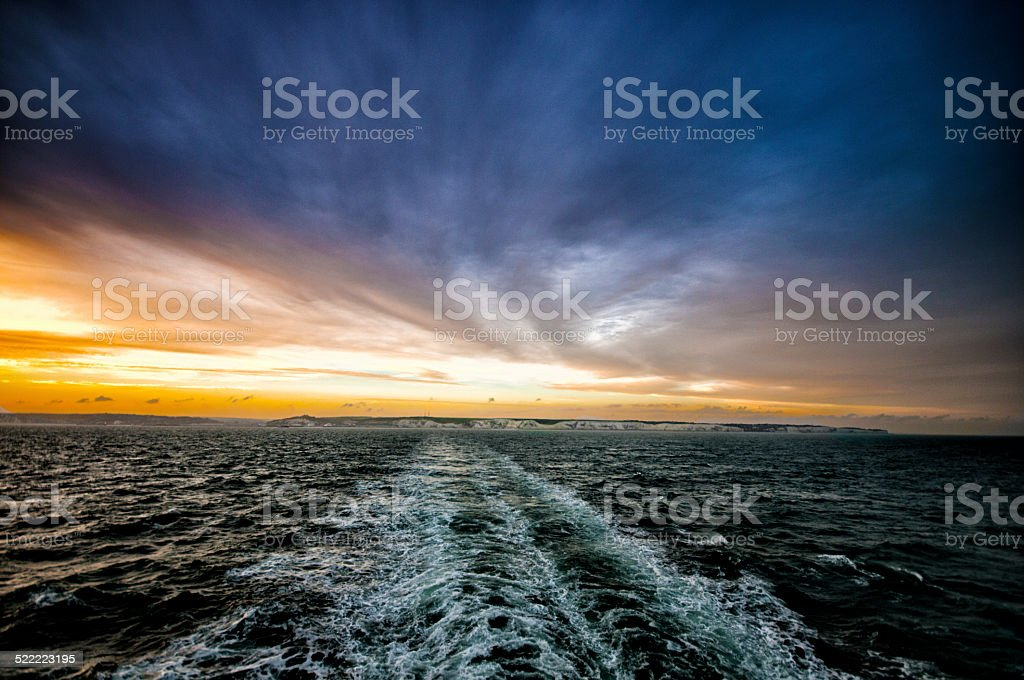 Looking back at the White cliffs of  Dover from Ferry stock photo