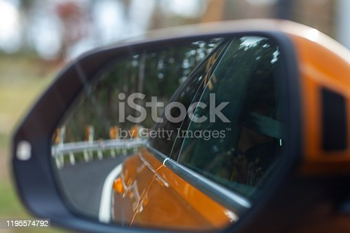 Looking back in the car's rearview mirror. Career and life image.