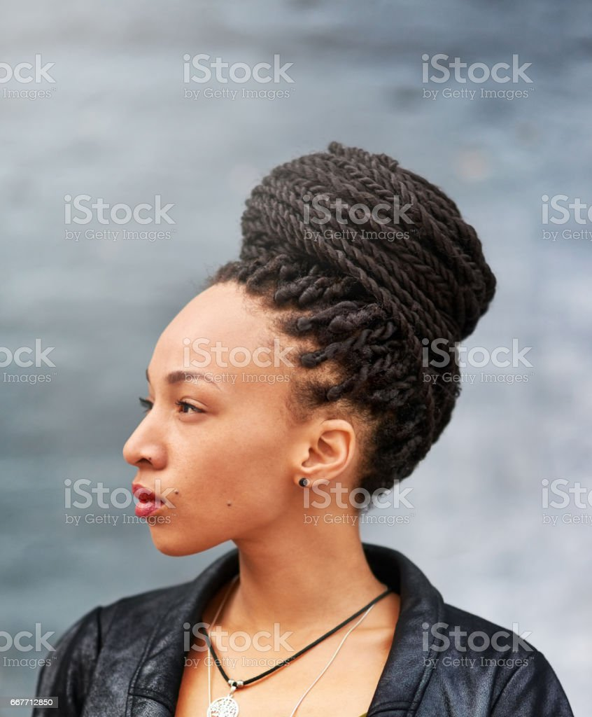 Looking beautiful in her braided bun stock photo