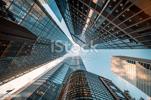Highly detailed abstract wide angle view up towards the sky in the financial district of London City and its ultra modern contemporary buildings with unique architecture. Shot on Canon EOS R full frame with prime 10mm extreme wide angle lens. Image is ideal for background.