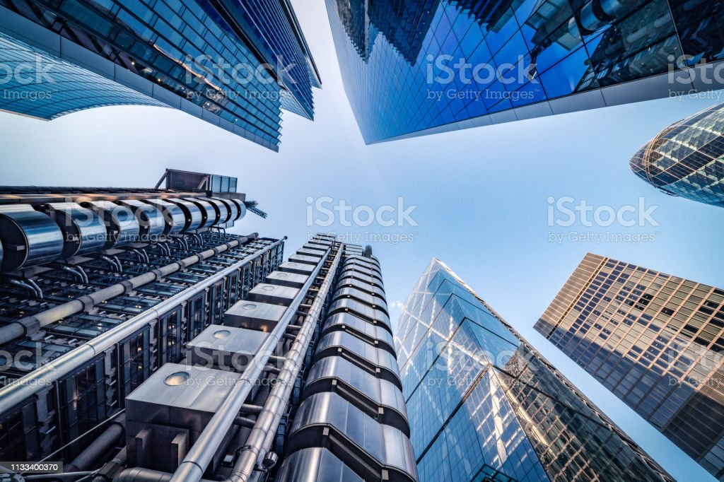 Looking directly up at the skyline of the financial district in central London - stock image - Royalty-free 2019 Foto de stock