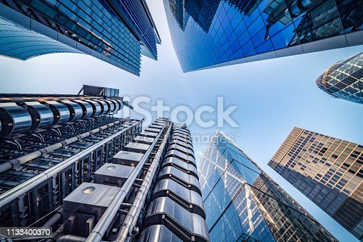 Highly detailed abstract wide angle view up towards the sky in the financial district of London City and its ultra modern contemporary buildings with unique architecture. Shot on Canon EOS R full frame with 14mm wide angle lens. Image is ideal for background.