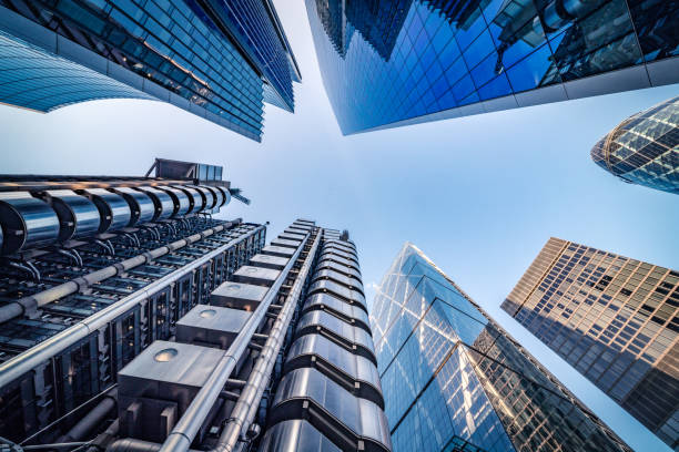 Looking directly up at the skyline of the financial district in central London - stock image Highly detailed abstract wide angle view up towards the sky in the financial district of London City and its ultra modern contemporary buildings with unique architecture. Shot on Canon EOS R full frame with 14mm wide angle lens. Image is ideal for background. skyscraper stock pictures, royalty-free photos & images