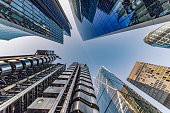 istock Looking directly up at the skyline of the financial district in central London city - stock image 1160940953