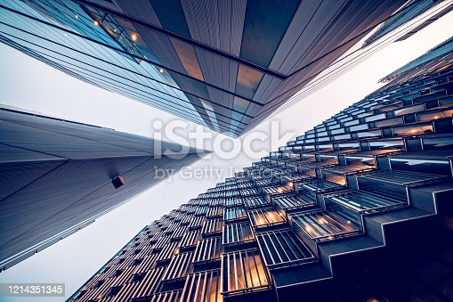 istock Looking directly up at the skyline of the financial district in central London - stock image 1214351345