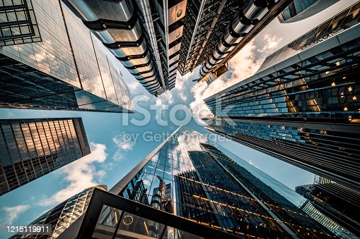 Highly detailed abstract wide angle view up towards the sky in the financial district of London City and its ultra modern contemporary buildings with unique architecture. Shot on Canon EOS R full frame with 10mm wide angle lens. Image is ideal for background.