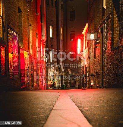 Melbourne, Australia - December 31, 2017: Looking down a laneway at night along Flinders lane.